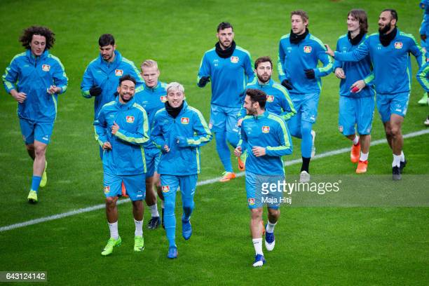 Karim Bellarabi Kevin Kampl Hakan Calhanoglu and the team of Leverkusen warm up during the training prior the UEFA Champions League Round of 16 first...