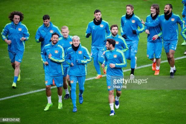Karim Bellarabi Kevin Kampl Hakan Calhanoglu and the team of Leverkusen warm up during the training prior the UEFA Champions League Round of 16 first...