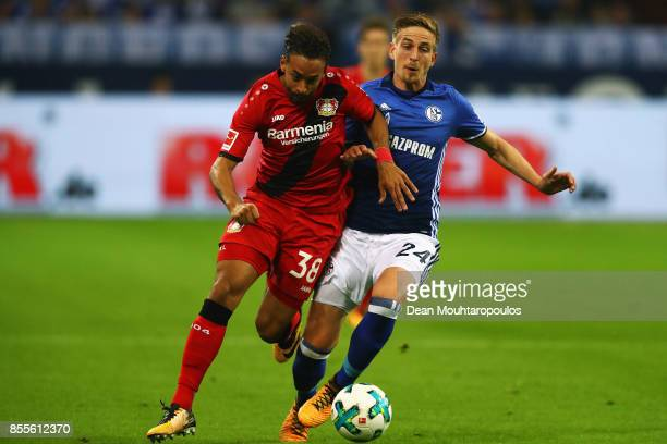 Karim Bellarabi of Bayer 04 Leverkusen battles for the ball with Bastian Oczipka of Schalke 04 during the Bundesliga match between FC Schalke 04 and...