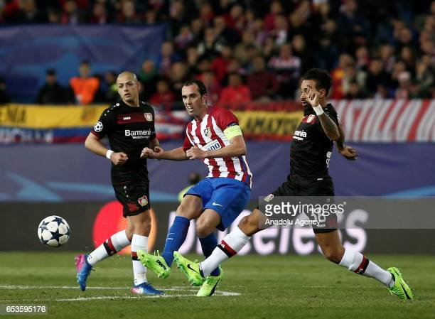 Karim Bellarabi of Bayer 04 Leverkusen in action against Diego Godin of Atletico Madrid during the UEFA Champions League Round of 16 football match...
