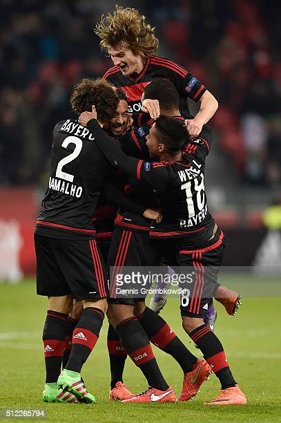 Karim Bellarabi of Bayer Leverkusen celebrates scoring his team's second goal with his team mates during the UEFA Europa League round of 32 second...