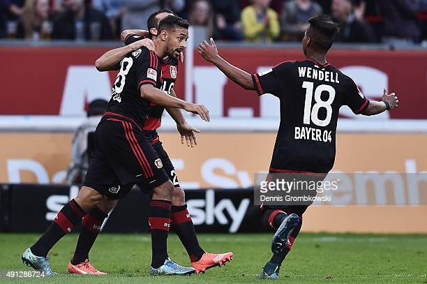 Karim Bellarabi of Bayer Leverkusen celebrates with team mates as he scores his team's first goal during the Bundesliga match between Bayer...