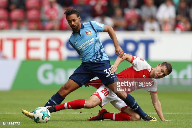 Karim Bellarabi of Bayer Leverkusen fights for the ball with Fabian Frei of Mainz during the Bundesliga match between 1 FSV Mainz 05 and Bayer 04...