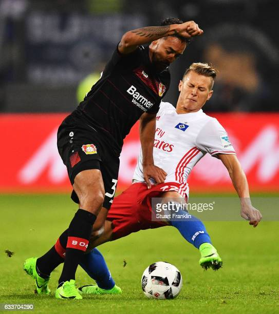 Karim Bellarabi of Bayer Leverkusen is challenged by Matthias Ostrzolek of Hamburger SV during the Bundesliga match between Hamburger SV and Bayer 04...