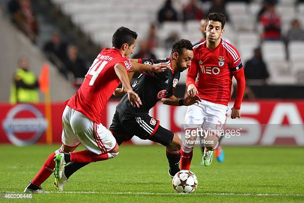 Karim Bellarabi of Bayer Leverkusen is pursued by Bryan Cristante of Benfica during the UEFA Champions League group C match between SL Benfica and...
