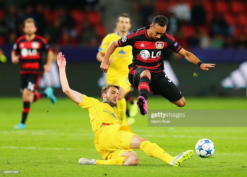 Karim Bellarabi of Bayer Leverkusen is tackled by Nemanja Milunovic of BATE during the UEFA Champions League Group E match between Bayer 04 Leverkusen and FC BATE Borisov at BayArena on September 16, 2015 in Leverkusen, Germany.
