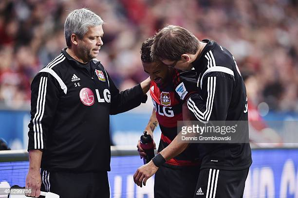 Karim Bellarabi of Bayer Leverkusen reacts as he receives medical treatment after suffering an injury during the Bundesliga match between Bayer...