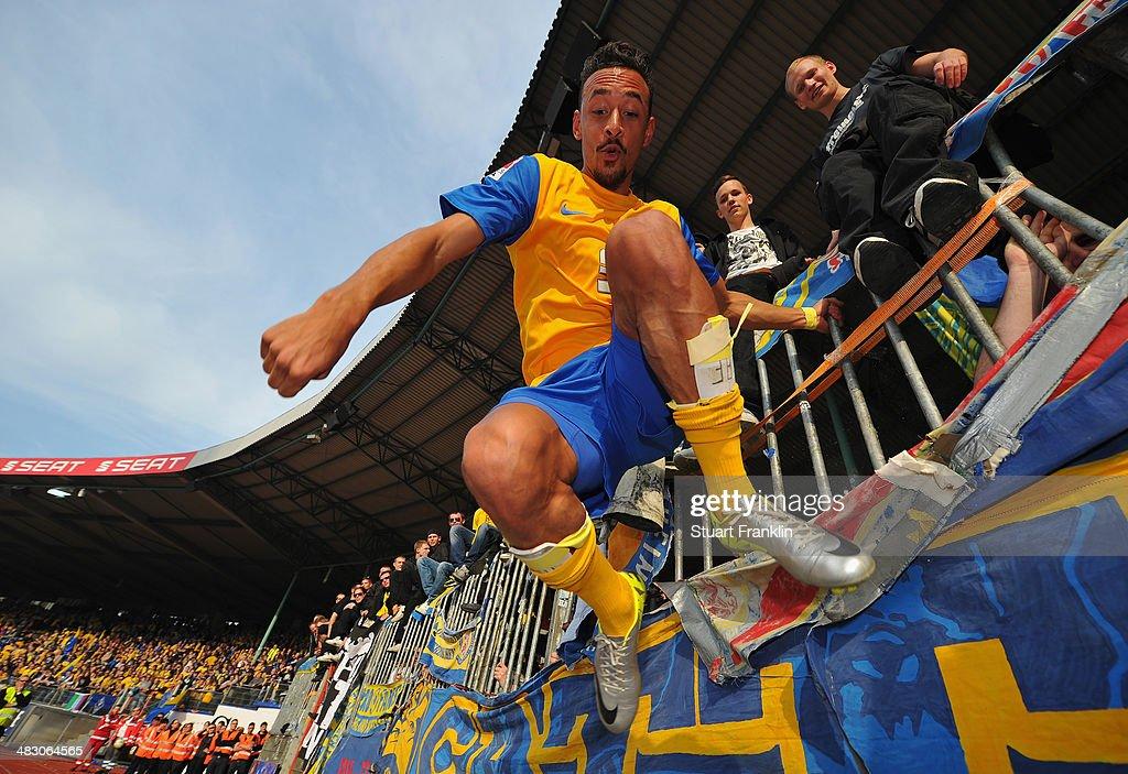 Karim Bellarabi of Braunschweig celebrates with their fans at the end of the Bundesliga match between Eintracht Braunschweig and Hannover 96 at Eintracht Stadion on April 6, 2014 in Braunschweig, Germany.