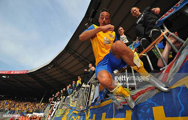 Karim Bellarabi of Braunschweig celebrates with their fans at the end of the Bundesliga match between Eintracht Braunschweig and Hannover 96 at...