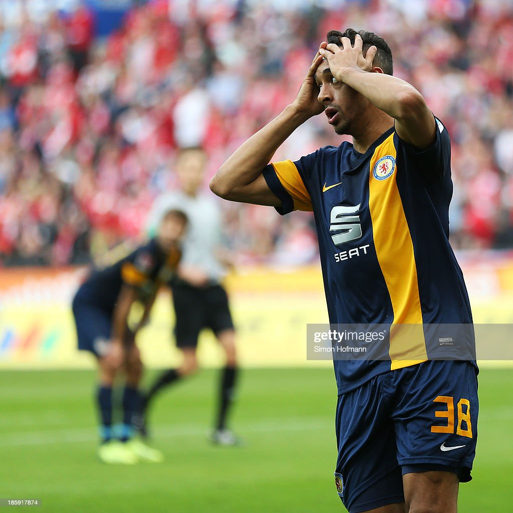 <a gi-track='captionPersonalityLinkClicked' href=/galleries/search?phrase=Karim+Bellarabi&family=editorial&specificpeople=7158972 ng-click='$event.stopPropagation()'>Karim Bellarabi</a> of Braunschweig reacts during the Bundesliga match between 1. FSV Mainz and Eintracht Braunschweig at Coface Arena on October 26, 2013 in Mainz, Germany.