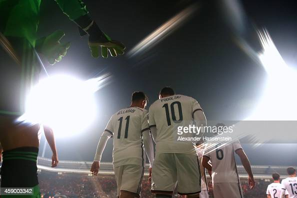 Karim Bellarabi of Germany enters the field with his team mate Lukas Podolski Sami Khedira Shkodran Mustafi Thomas Mueller and keeper Manuel Neuer...