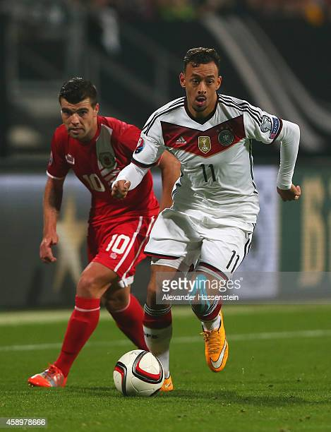 Karim Bellarabi of Germany goes past Liam Walker of Gibraltar during the EURO 2016 Group D Qualifier match between Germany and Gibraltar at Grundig...