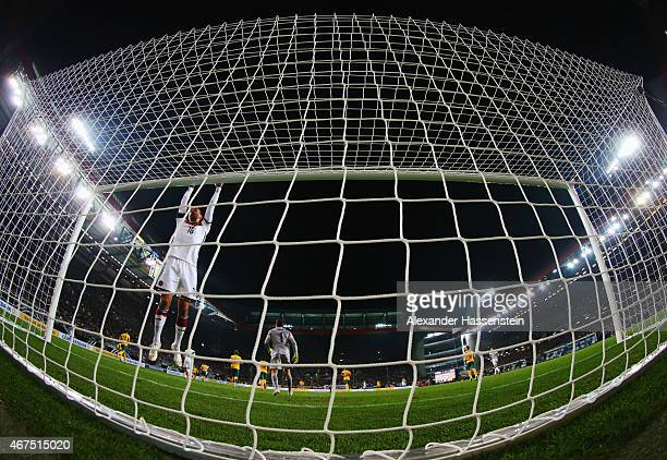 Karim Bellarabi of Germany swings on the crossbar during the international friendly match between Germany and Australia at FritzWalterStadion on...