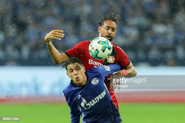 Karim Bellarabi of Leverkusen and Amine Harit of Schalke battle for the ball during the Bundesliga match between FC Schalke 04 and Bayer 04...