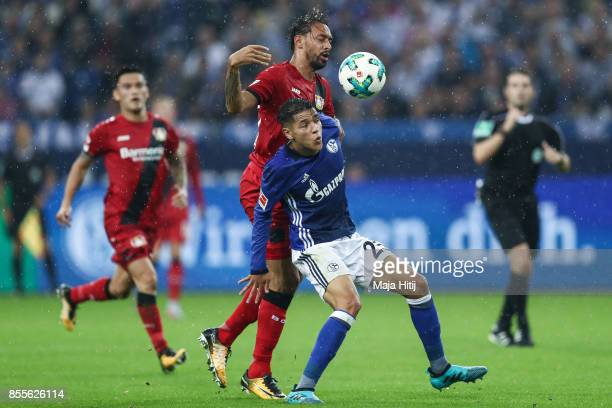 Karim Bellarabi of Leverkusen and Amine Haritg of Schalke battle for the ball during the Bundesliga match between FC Schalke 04 and Bayer 04...