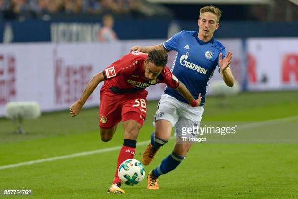 Karim Bellarabi of Leverkusen and Bastian Oczipka of Schalke battle for the ball during the Bundesliga match between FC Schalke 04 and Bayer 04...