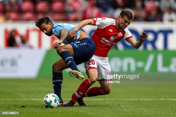 Karim Bellarabi of Leverkusen and Fabian Frei of Mainz battle for the ball the ball the Bundesliga match between 1 FSV Mainz 05 and Bayer 04...