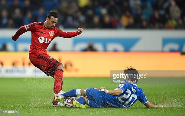 Karim Bellarabi of Leverkusen and JinSu Kim of Hoffenheim compete for the ball during the Bundesliga match between 1899 Hoffenheim and Bayer 04...