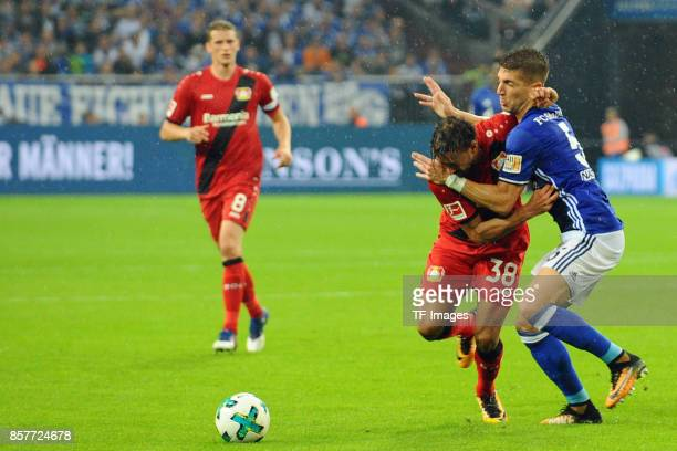 Karim Bellarabi of Leverkusen and Matija Nastasic of Schalke battle for the ball during the Bundesliga match between FC Schalke 04 and Bayer 04...