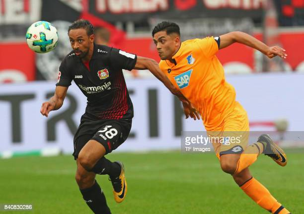 Karim Bellarabi of Leverkusen and Nadiem Amiri of Hoffenheim battle for the ball during the Bundesliga match between Bayer 04 Leverkusen and TSG 1899...