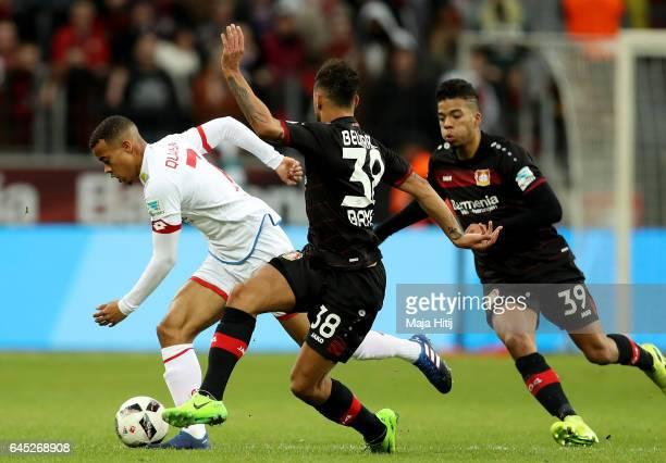 Karim Bellarabi of Leverkusen and Quaison of Mainz battle for the ball during the Bundesliga match between Bayer 04 Leverkusen and 1 FSV Mainz 05 at...