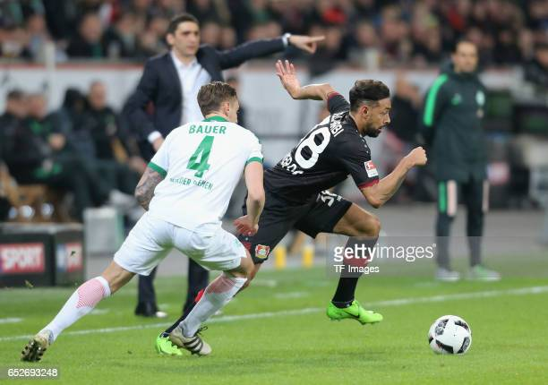Karim Bellarabi of Leverkusen and Robert Bauer of Bremen battle for the ball during the Bundesliga soccer match between Bayer Leverkusen and Werder...