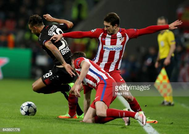 Karim Bellarabi of Leverkusen and Sime Vrsaljko of Atletico battle for the ball during the UEFA Champions League Round of 16 first leg match between...