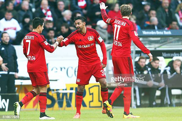 Karim Bellarabi of Leverkusen celebrates his team's second goal with team mates Javier Hernandez and Stefan Kiessling during the Bundesliga match...