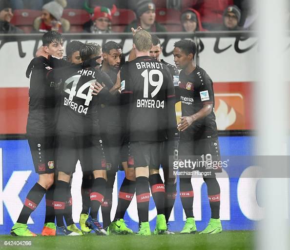 Karim Bellarabi of Leverkusen celebrates scoring the 50000th goal in the Bundesliga during the Bundesliga match between FC Augsburg and Bayer 04...