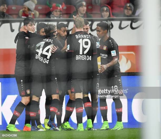Karim Bellarabi of Leverkusen celebrates scoring the 50000th goal in the Bundesliga during the Bundesliga match between FC Augsburg and Bayer 04...
