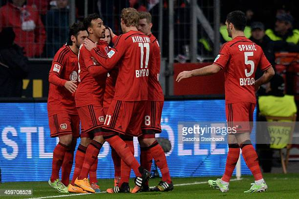 Karim Bellarabi of Leverkusen celebrates with team mates after scoring his team's first goal during the Bundesliga match between Bayer 04 Leverkusen...