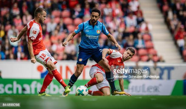 Karim Bellarabi of Leverkusen in action against Daniel Brosinski of Mainz during the Bundesliga match between 1 FSV Mainz 05 and Bayer 04 Leverkusen...