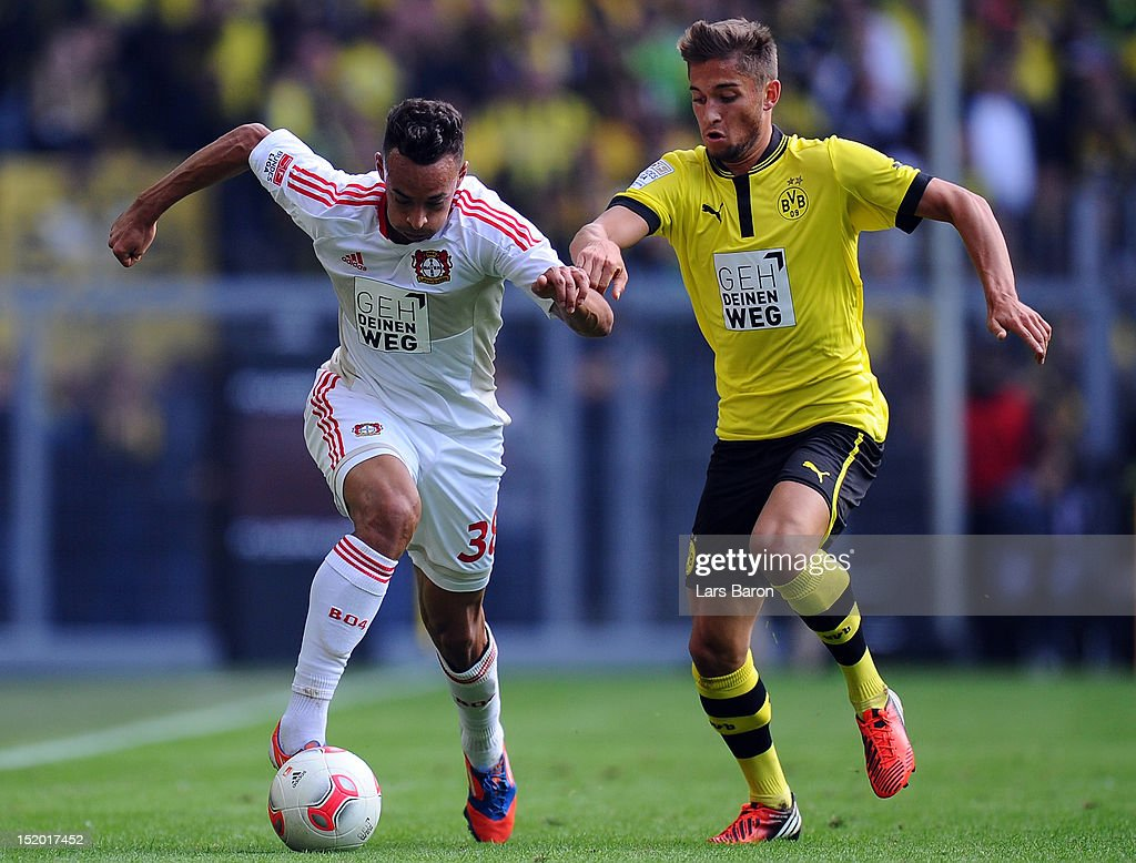 Karim Bellarabi of Leverkusen is challenged by <a gi-track='captionPersonalityLinkClicked' href=/galleries/search?phrase=Moritz+Leitner&family=editorial&specificpeople=7118695 ng-click='$event.stopPropagation()'>Moritz Leitner</a> of Dortmund during the Bundesliga match between Borussia Dortmund and Bayer 04 Leverkusen at Signal Iduna Park on September 15, 2012 in Dortmund, Germany.