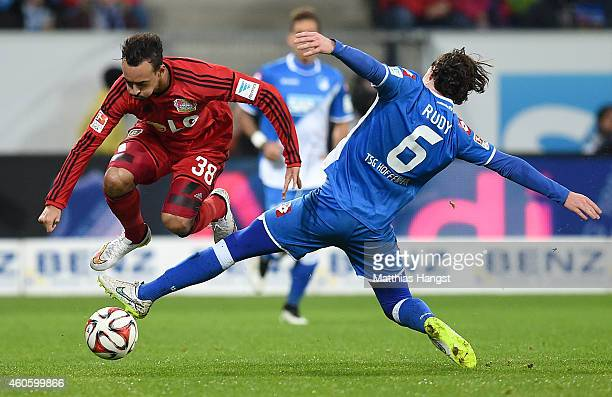 Karim Bellarabi of Leverkusen is challenged by Sebastian Rudy of Hoffenheim during the Bundesliga match between 1899 Hoffenheim and Bayer 04...