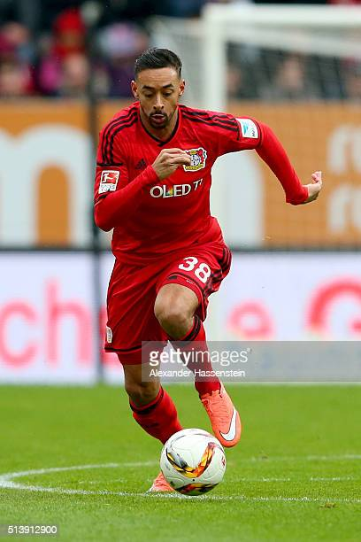 Karim Bellarabi of Leverkusen runs with the ball during the Bundesliga match between FC Augsburg and Bayer Leverkusen at WWK Arena on March 5 2016 in...