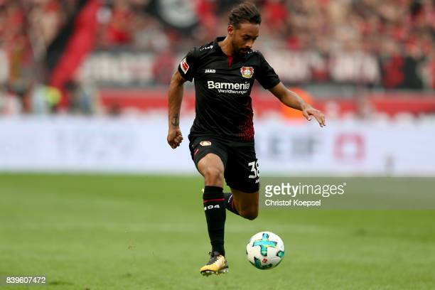 Karim Bellarabi of Leverkusen runs with the ball during the Bundesliga match between Bayer 04 Leverkusen and TSG 1899 Hoffenheim at BayArena on...