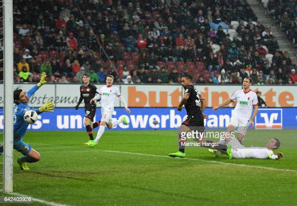 Karim Bellarabi of Leverkusen scores the 50000th goal in the Bundesliga during the Bundesliga match between FC Augsburg and Bayer 04 Leverkusen at...