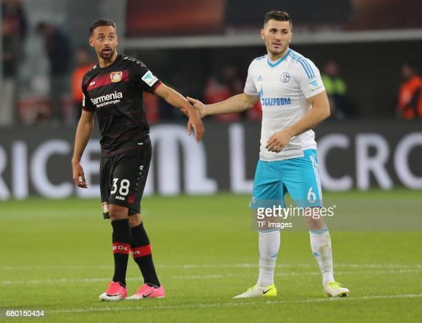 Karim Bellarabi of Leverkusen shakes hands with Sead Kolasinac of Schalke during to the Bundesliga match between Bayer 04 Leverkusen and FC Schalke...