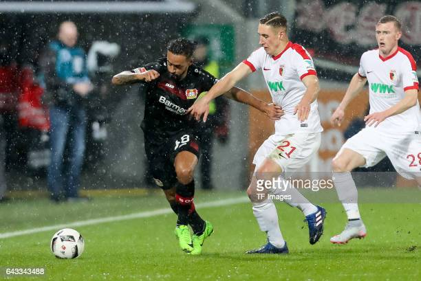 Karim Bellarabi of Leverkusen und Dominik Kohr of Augsburg battle for the ball during the Bundesliga match between FC Augsburg and Bayer 04...