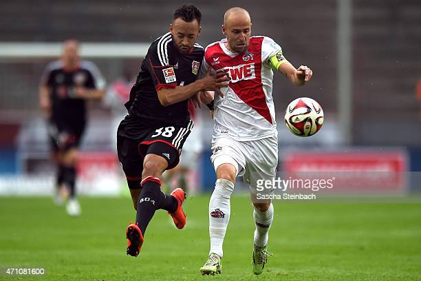 Karim Bellarabi of Leverkusen vies with Miso Brecko of Koeln during the Bundesliga match between 1 FC Koeln and Bayer 04 Leverkusen at...