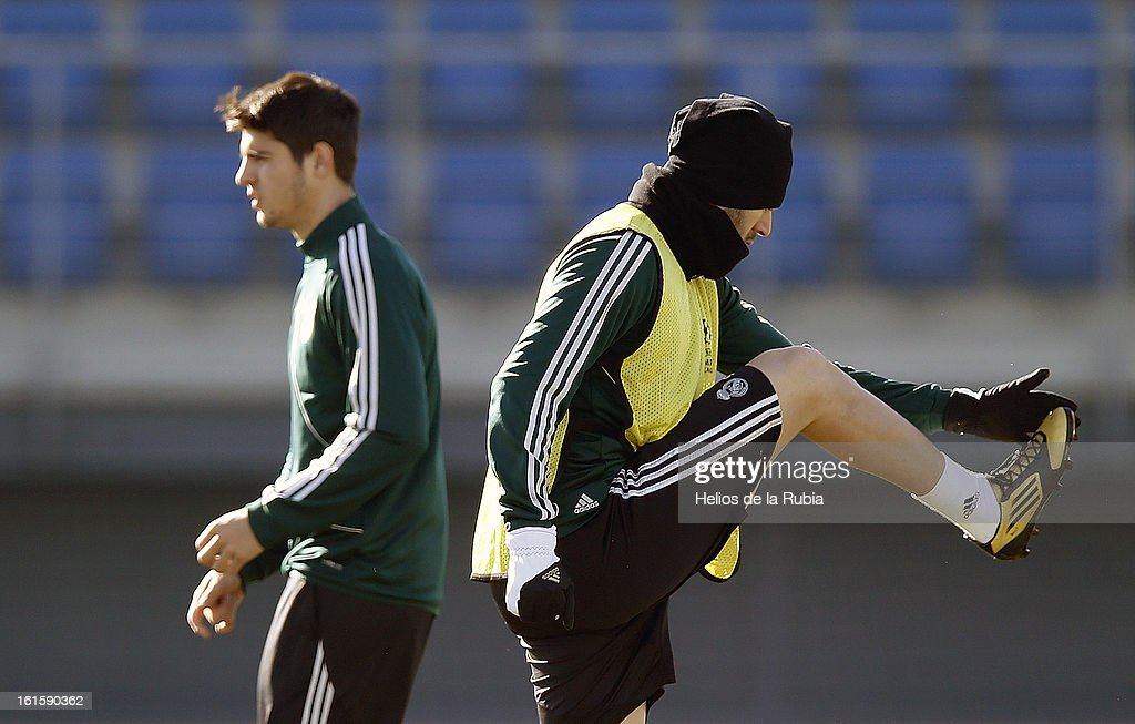 Karim Benzema (R) and Alvaro Morata of Real Madrid exercise during a training session ahead of the UEFA Champions League match between Real Madrid CF and Manchester United at the Valdebebas training ground on February 12, 2013 in Madrid, Spain.
