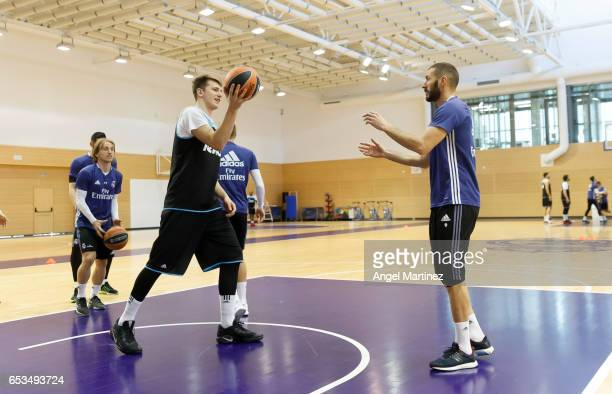Karim Benzema and basketball player Luka Doncic of Real Madrid in action during a training session at Ciudad Real Madrid basketball court on March 14...
