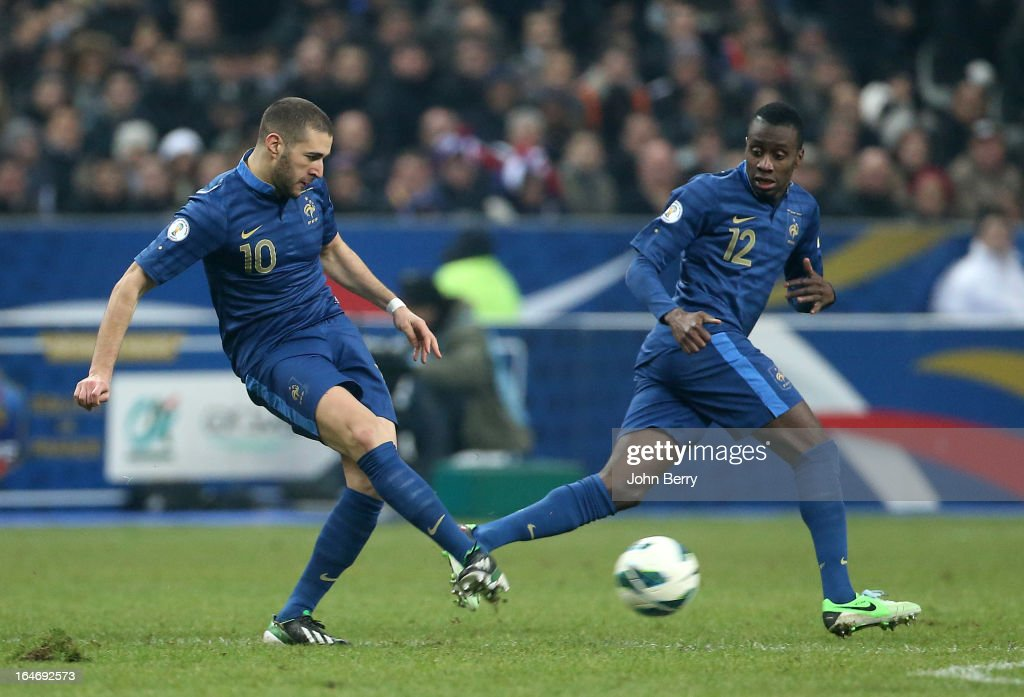 <a gi-track='captionPersonalityLinkClicked' href=/galleries/search?phrase=Karim+Benzema&family=editorial&specificpeople=796089 ng-click='$event.stopPropagation()'>Karim Benzema</a> and Blaise Matuidi of France in action during the FIFA World Cup 2014 qualifier match between France and Spain at the Stade de France on March 26, 2013 in Saint-Denis near Paris, France.