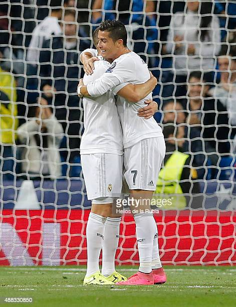 Karim Benzema and Cristiano Ronaldo of Real Madrid celebrate after scoring during the UEFA Champions League Group A match between Real Madrid CF and...