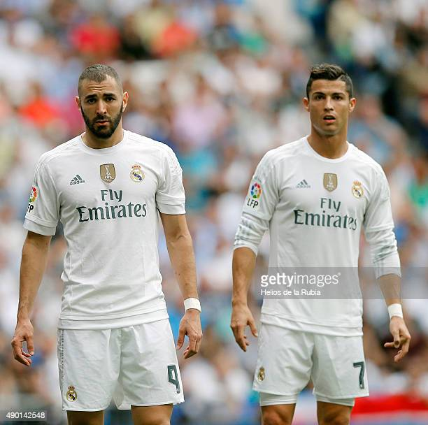 Karim Benzema and Cristiano Ronaldo of Real Madrid look on during the La Liga match between Real Madrid CF and Malaga CF at Estadio Santiago Bernabeu...