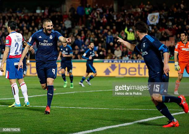 Karim Benzema and Dani Carvajal of Real Madrid celebrate after scoring during the La Liga match between Granada CF and Real Madrid CF at Nuevo...