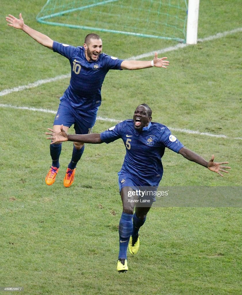 Karim Benzema and Mamadou Sakho (R) of France celebrate after the third goal during the FIFA 2014 World Cup Qualifier: Play-off Second Leg between France and Ukraine at Stade de France on November 19, 2013 in Paris, France.