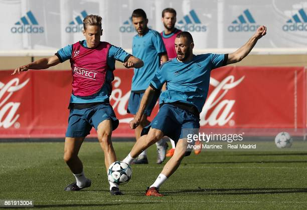 Karim Benzema and Marcos Llorente of Real Madrid in action during a training session at Valdebebas training ground on October 16 2017 in Madrid Spain