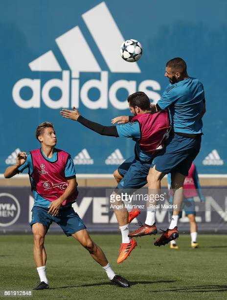 Karim Benzema and Nacho Fernandez of Real Madrid in action during a training session at Valdebebas training ground on October 16 2017 in Madrid Spain
