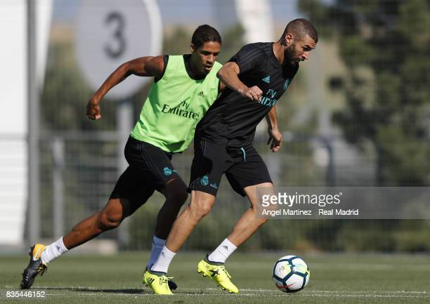 Karim Benzema and Raphael Varane of Real Madrid in action during a training session at Valdebebas training ground on August 19 2017 in Madrid Spain